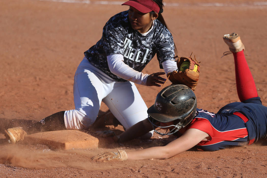Liberty's McKenzie LaNeve (42) slides safely back to third base against Desert Oasis&# ...