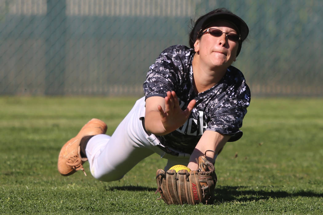 Desert Oasis' Makayla Rickard (23) makes a diving catch for an out against Liberty in ...