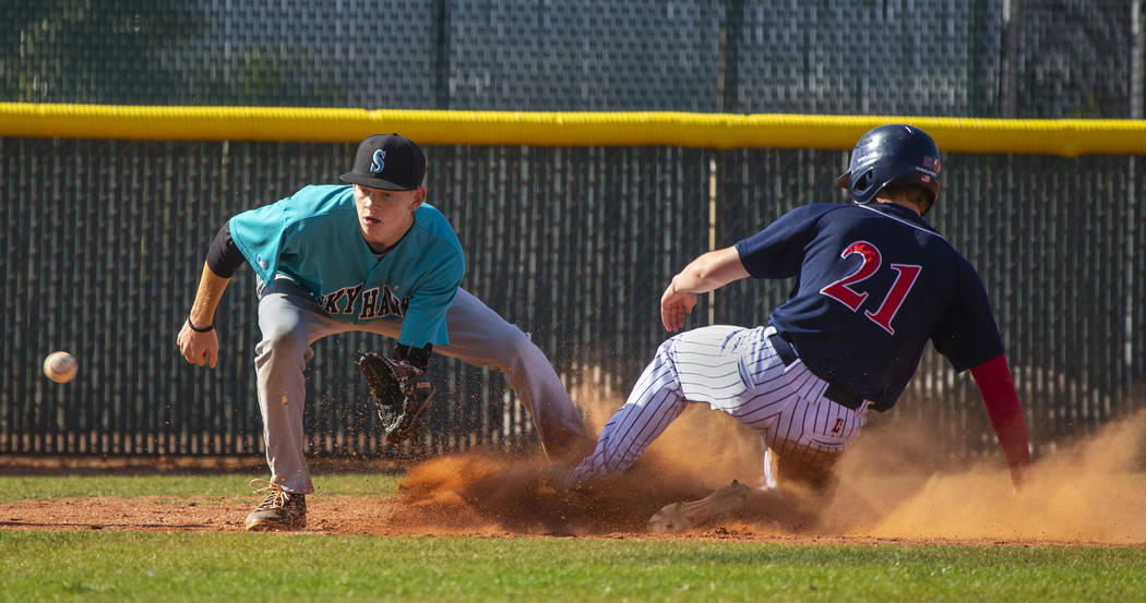 Silverado infielder Austin Whittaker (25) is unable to get the ball in time as Coronado runn ...