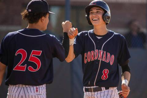 Coronado's Thomas Planellas (25) congratulates teammate Jett Kenyon (8) after scoring ...