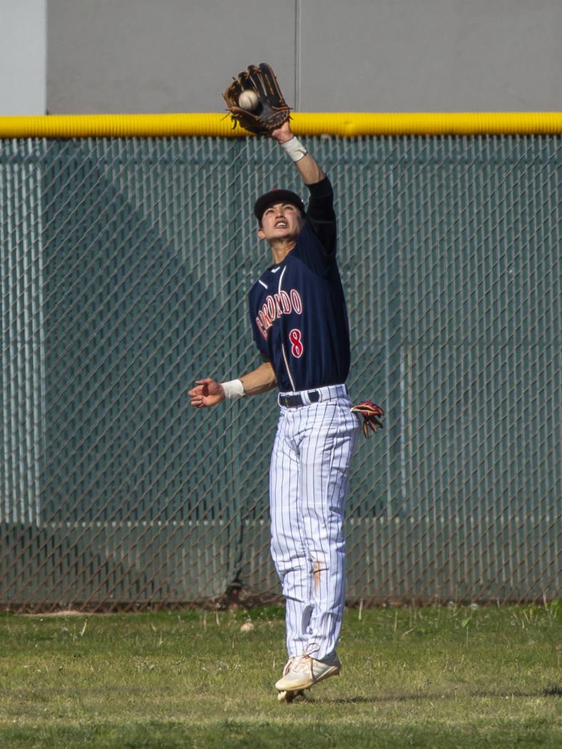 Coronado outfielder Jett Kenyon (8) elevates to make a deep catch versus Silverado during th ...