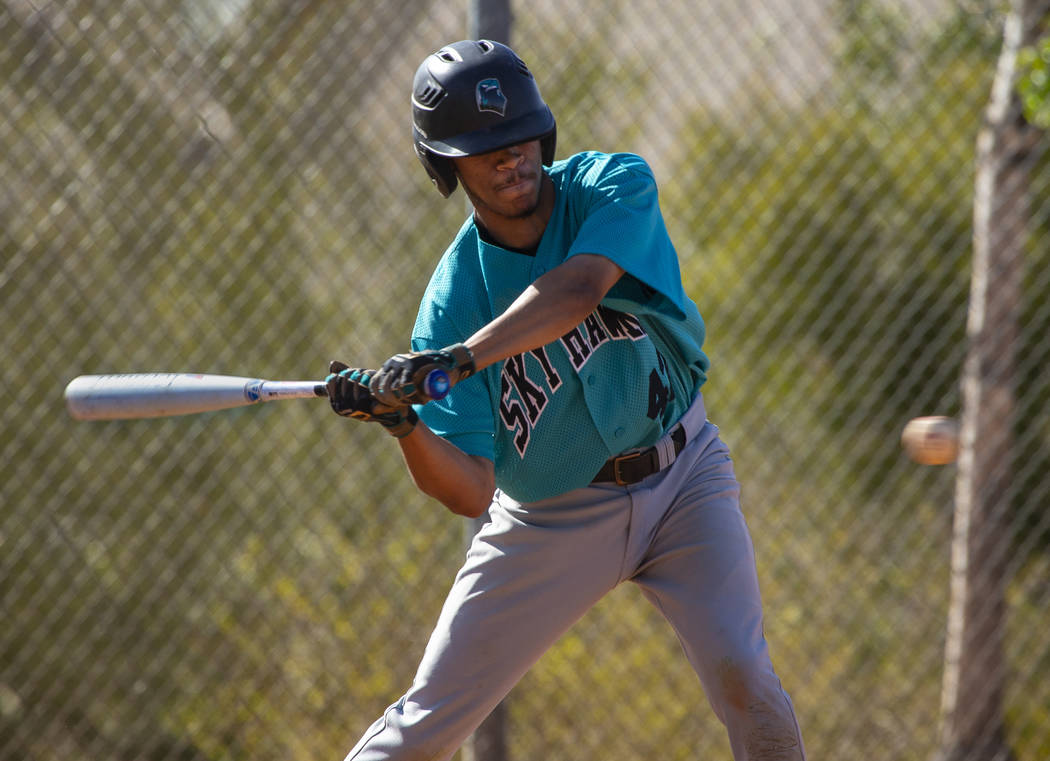 Silverado infielder Caleb Hubbard (42) eyes a pitch over the plate from Coronado during thei ...