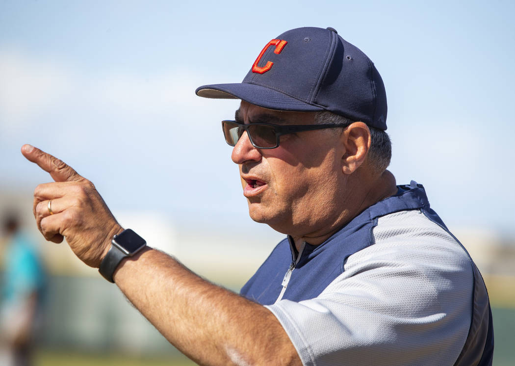 Coronado head coach Rich Santigate gives instruction a player versus Silverado during their ...