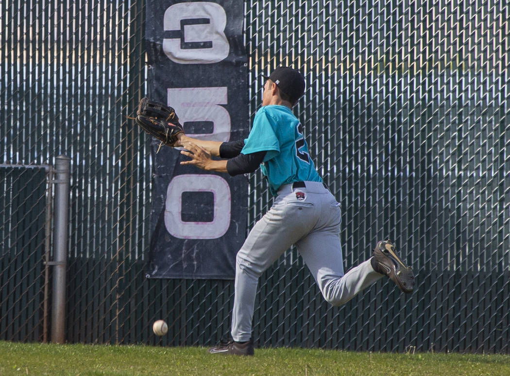 Silverado outfielder Ryeant Horacek (28) is unable to catch a long fly ball from a Coronado ...