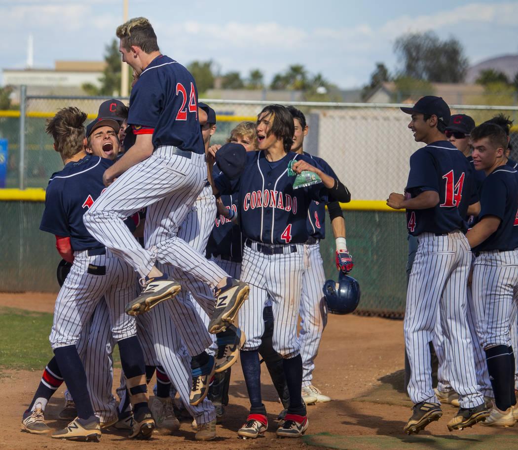 Coronado players celebrate a two-run home run while dominating Silverado during their baseba ...