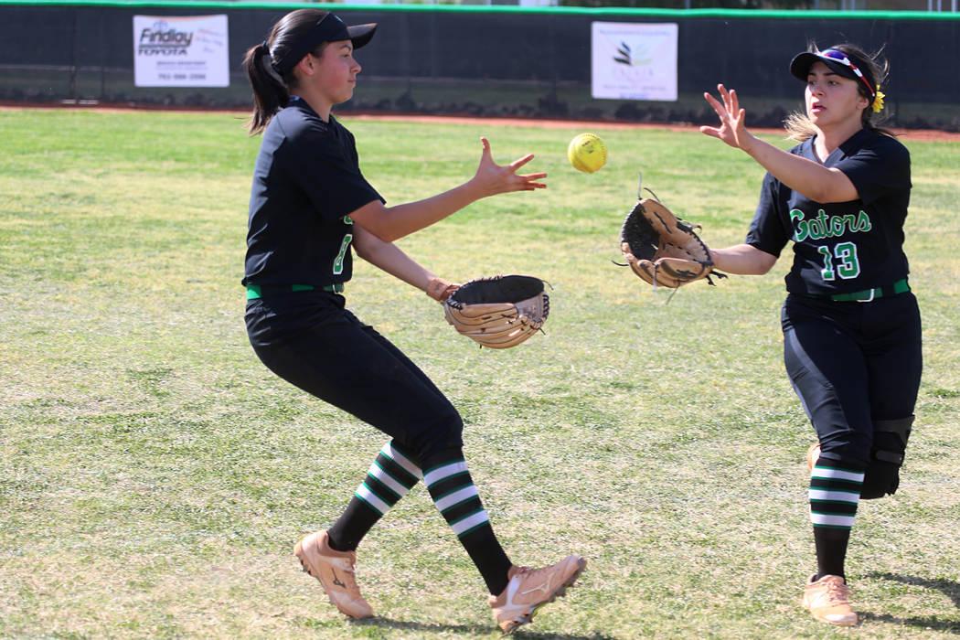 Green Valley's Alyssa Vigil (8), left, and Cinthia Garcia (13), watch as the ball drop ...