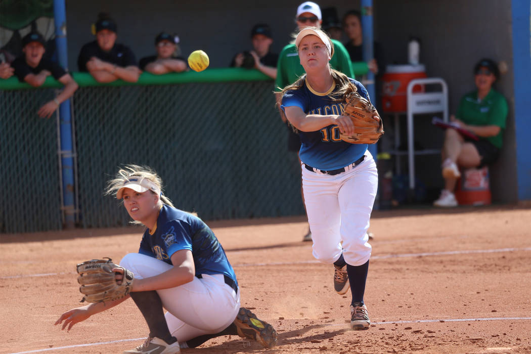 Foothill's Makenzie Andrews (10) throws to first base for an out as Leah Becker (5) du ...