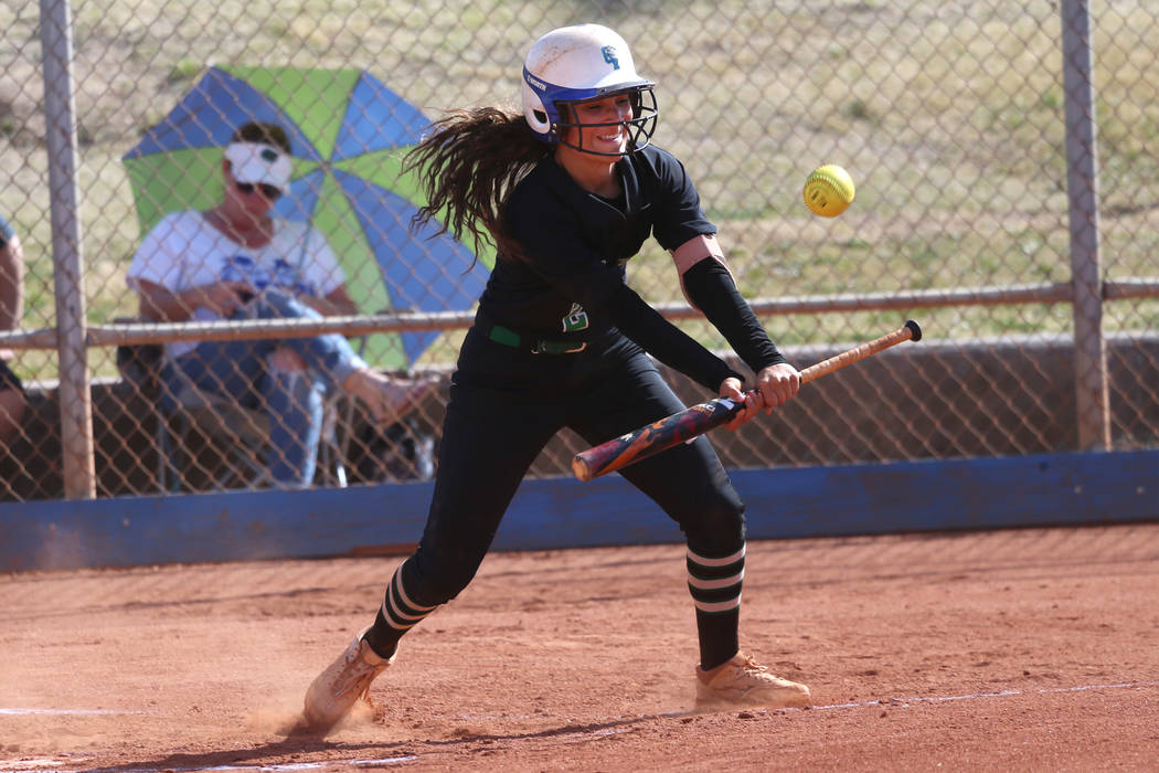 Green Valley's Olivia McClain (2) bunts the ball for a fly ball and an out against Foo ...