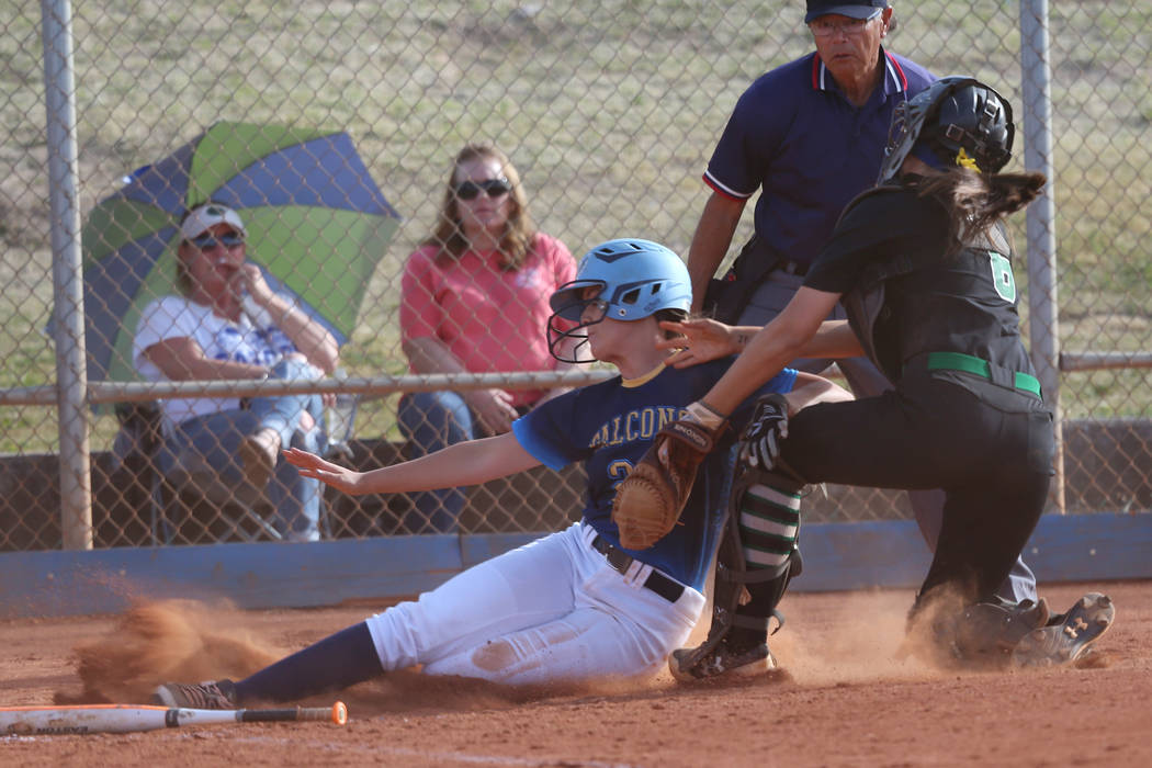 Foothill's Adrienne Higgins (21) slides home for an out against Green Valley's A ...