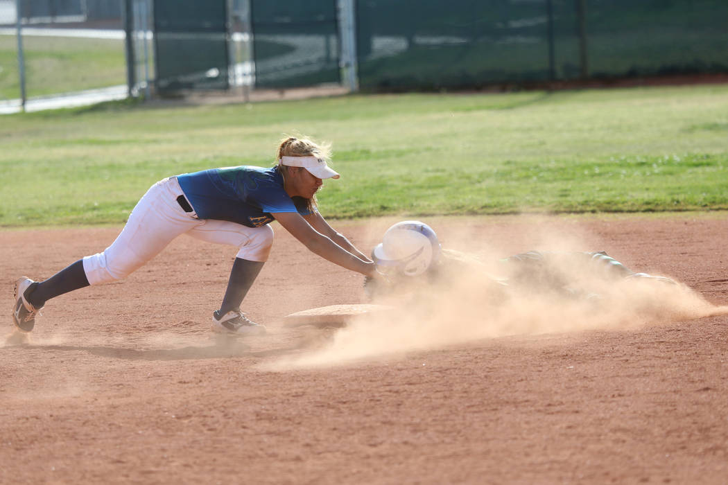 Foothill's Angelina Rodriguez (6) tags out Green Valley's Cindy Martinez-Escamil ...