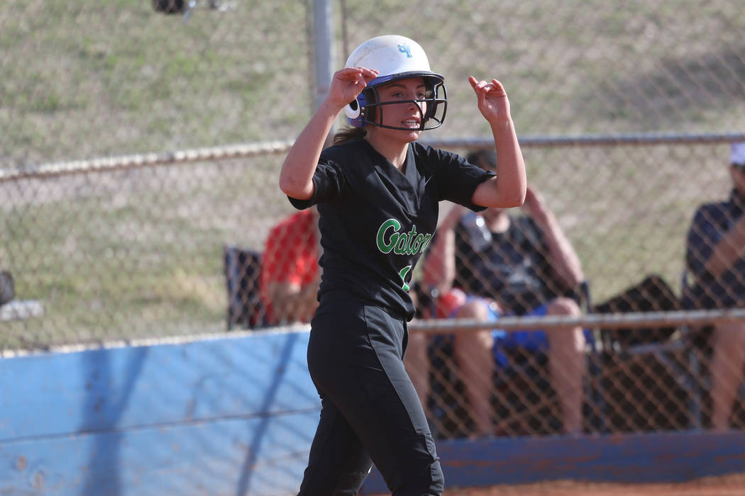Green Valley's Landree Galvin (4) celebrates after running home for a run against Foot ...
