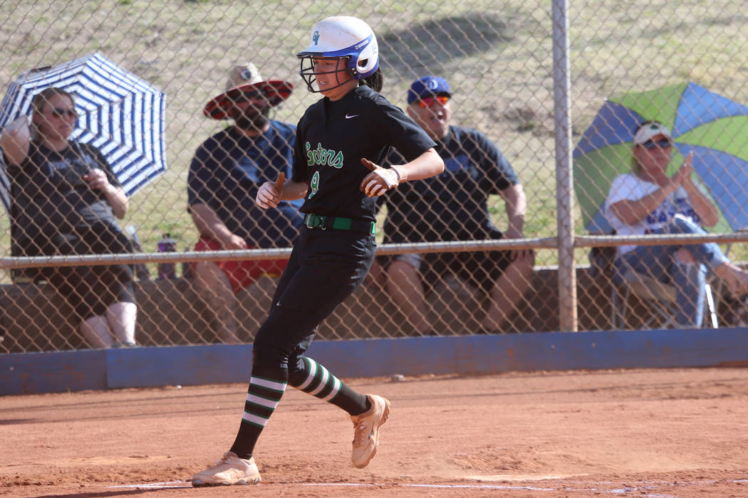Green Valley's Alyssa Vigil (8) runs home for a run against Foothill in the softball g ...