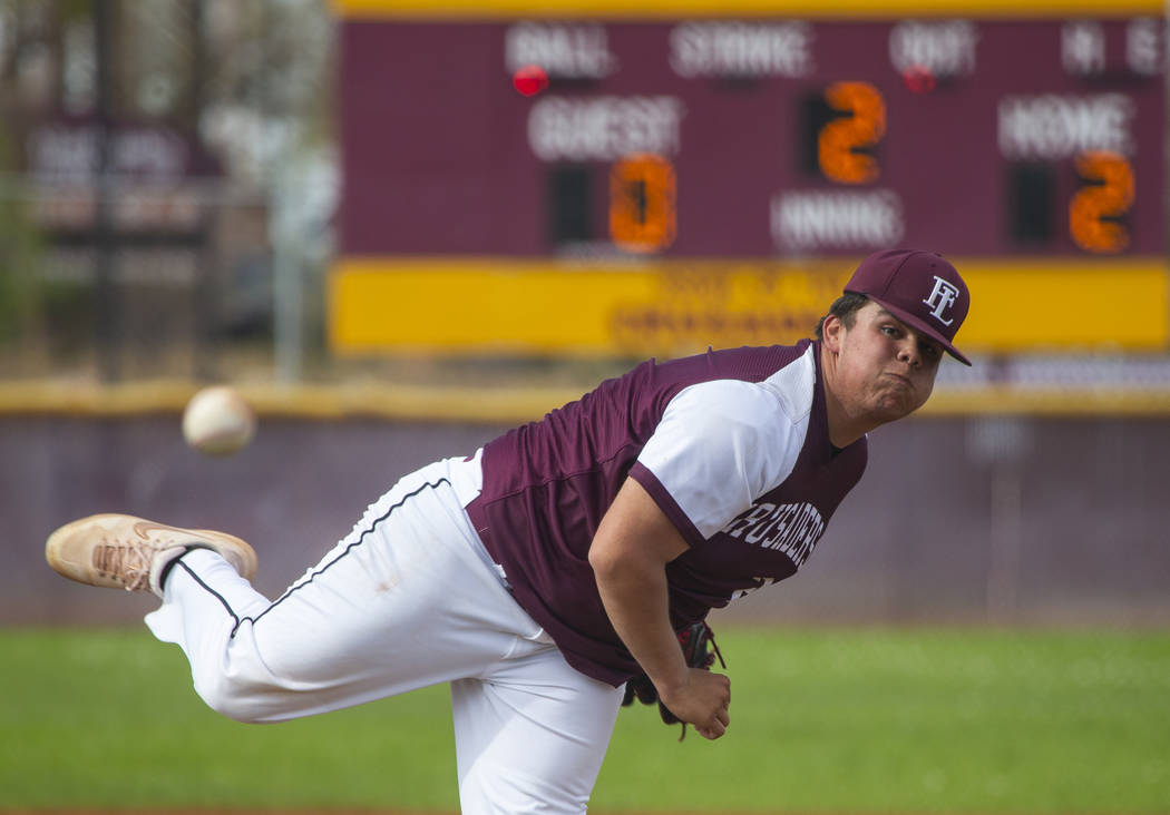 Faith Lutheran's pitcher Christian Dijkman (21) sends another ball towards the plate v ...