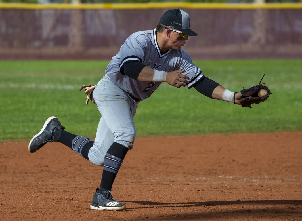 Palo Verde's Paul Myro IV (23) scoops up a grounder from a Faith lutheran batter durin ...