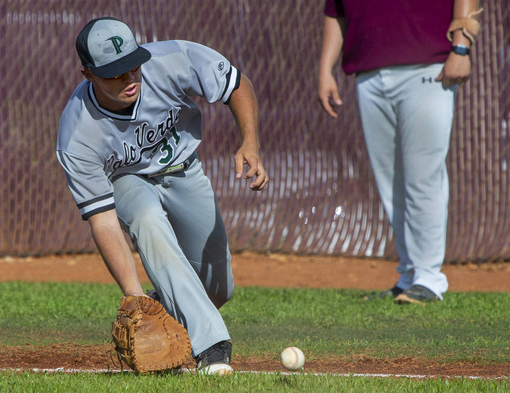 Palo Verde's Austin Raleigh (31) looks to a grounder from a Faith Lutheran batter duri ...