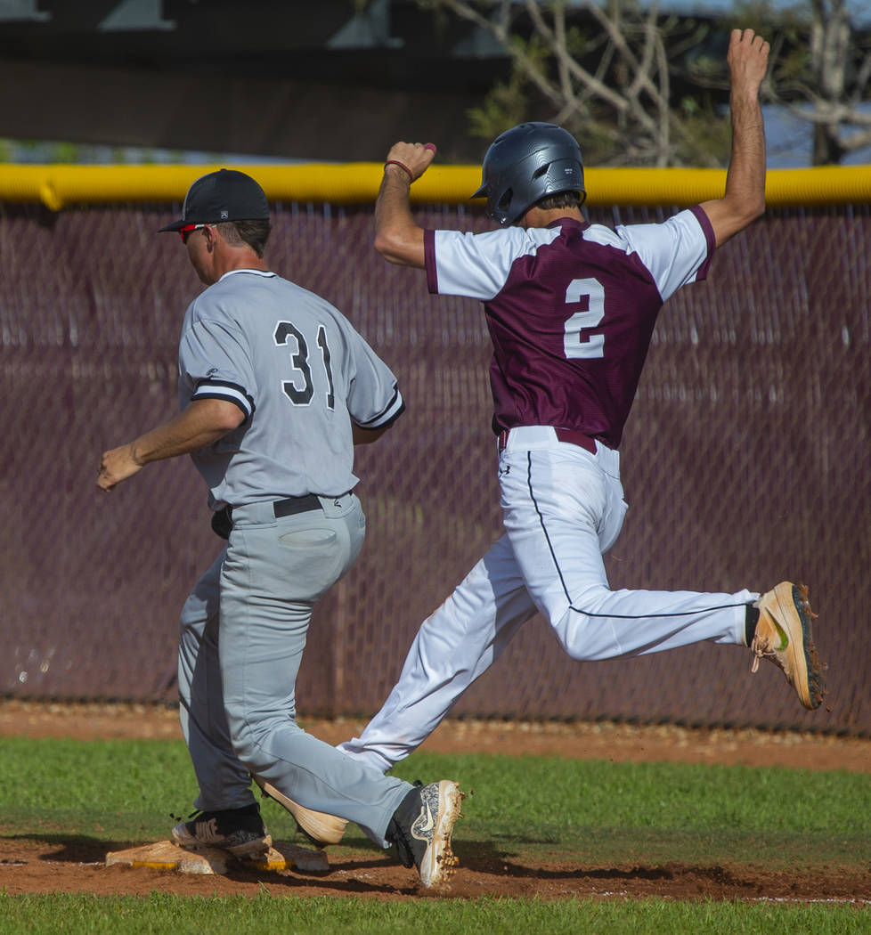 Palo Verde's Austin Raleigh (31) gets back to tag first base just ahead of Faith Luthe ...
