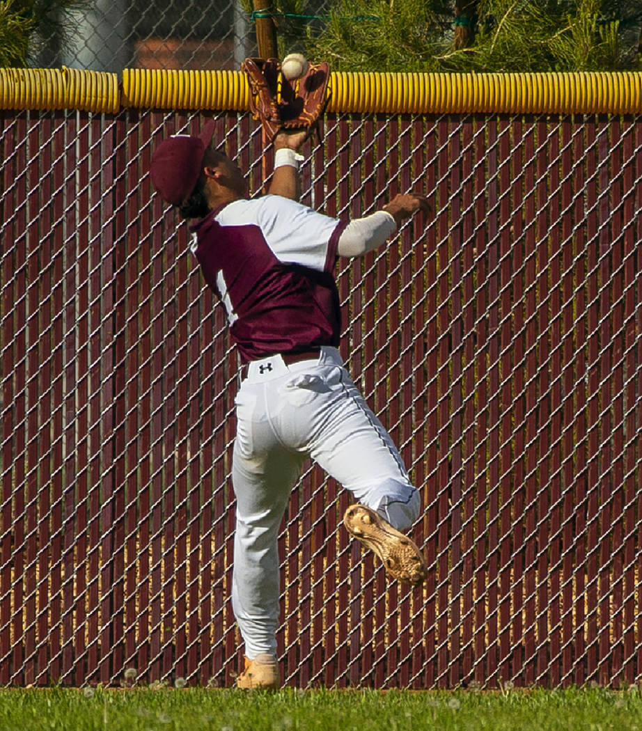 Faith Lutheran's Dylan Schafer (1) goes deep into center field for a catch from a Palo ...