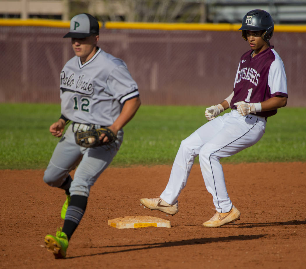 Palo Verde's (12) has to step off the bag for a wild throw as Faith Lutheran's D ...