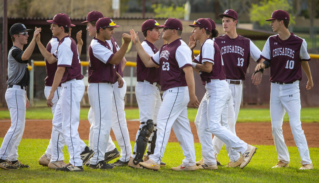 Faith Lutheran players celebrate their win over Palo Verde during their high school baseball ...