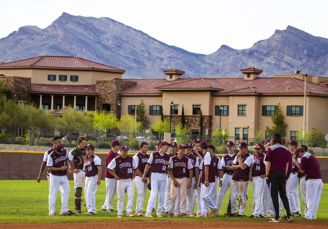 Faith Lutheran players come together and celebrate their win over Palo Verde during their hi ...