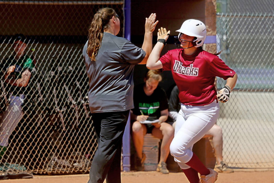 Desert Oasis Holly Severance (4) rounds the bases after a three-run homer against Rancho in ...