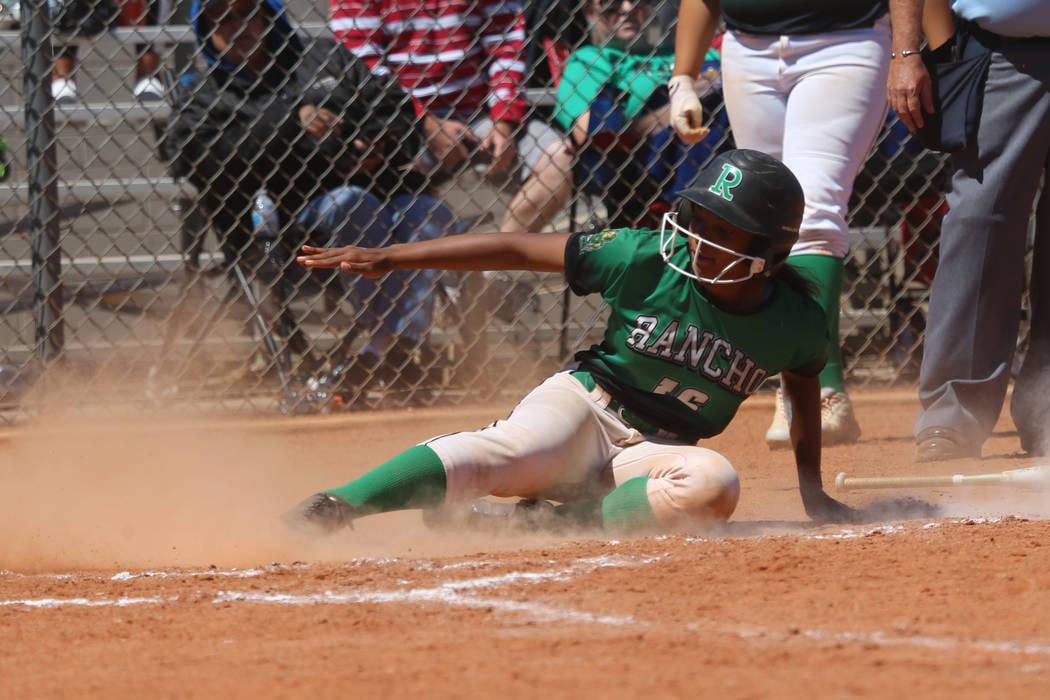 Rancho's Anaiya Irick (16) slides home for a run against Desert Oasis in the softball ...
