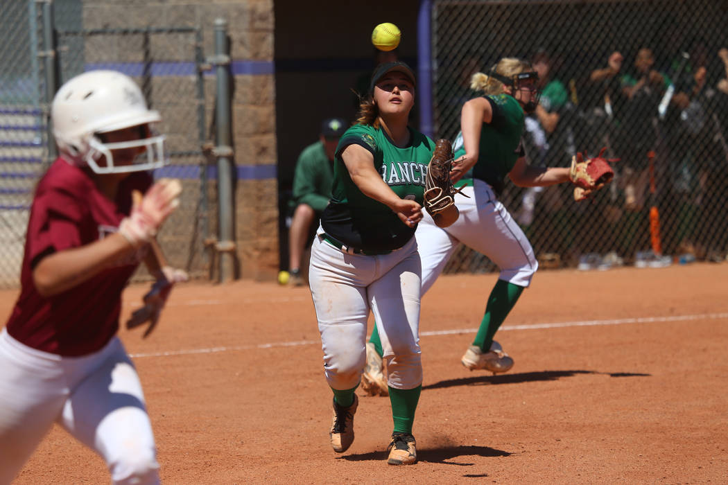 Rancho's Liliana Gutierrez (6) throws to first base for an out against Desert Oasis in ...