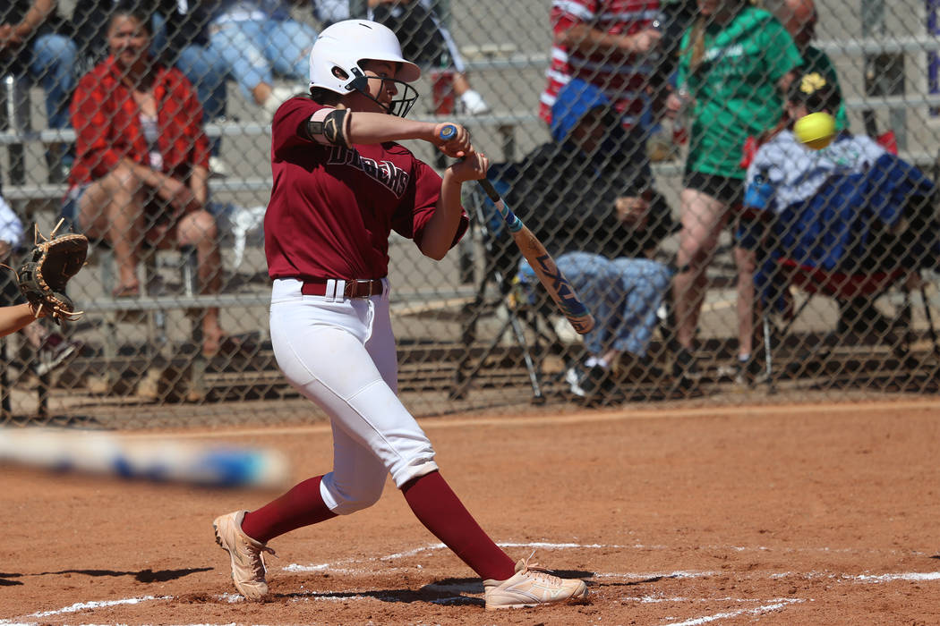 Desert Oasis Ruby Martinez (10) hits the ball for a single against Rancho in the softball ga ...