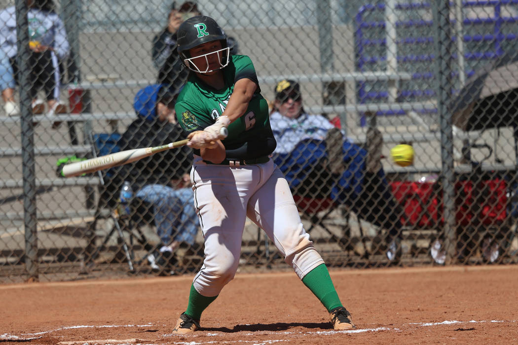 Rancho's Liliana Gutierrez (6) hits the ball for a solo homer against Desert Oasis in ...