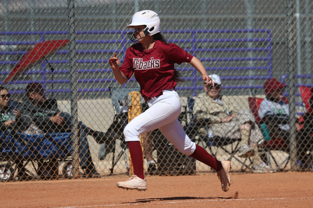 Desert Oasis Ruby Martinez (10) runs home for a run against Rancho in the softball game at D ...