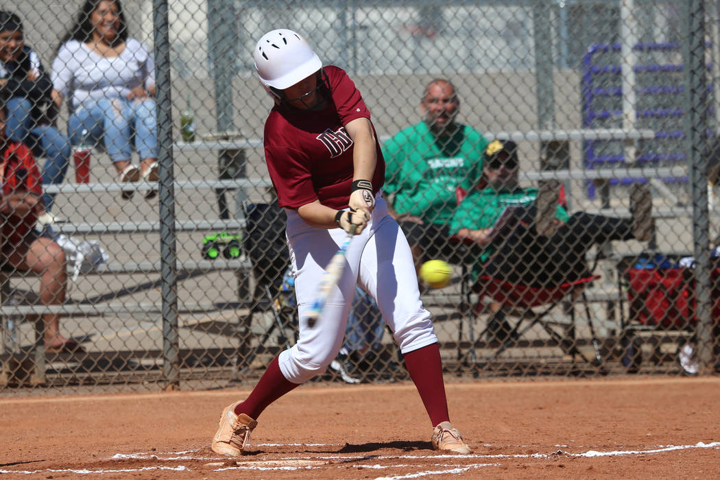Desert Oasis Holly Severance (4) hits a two-run double against Rancho in the softball game a ...