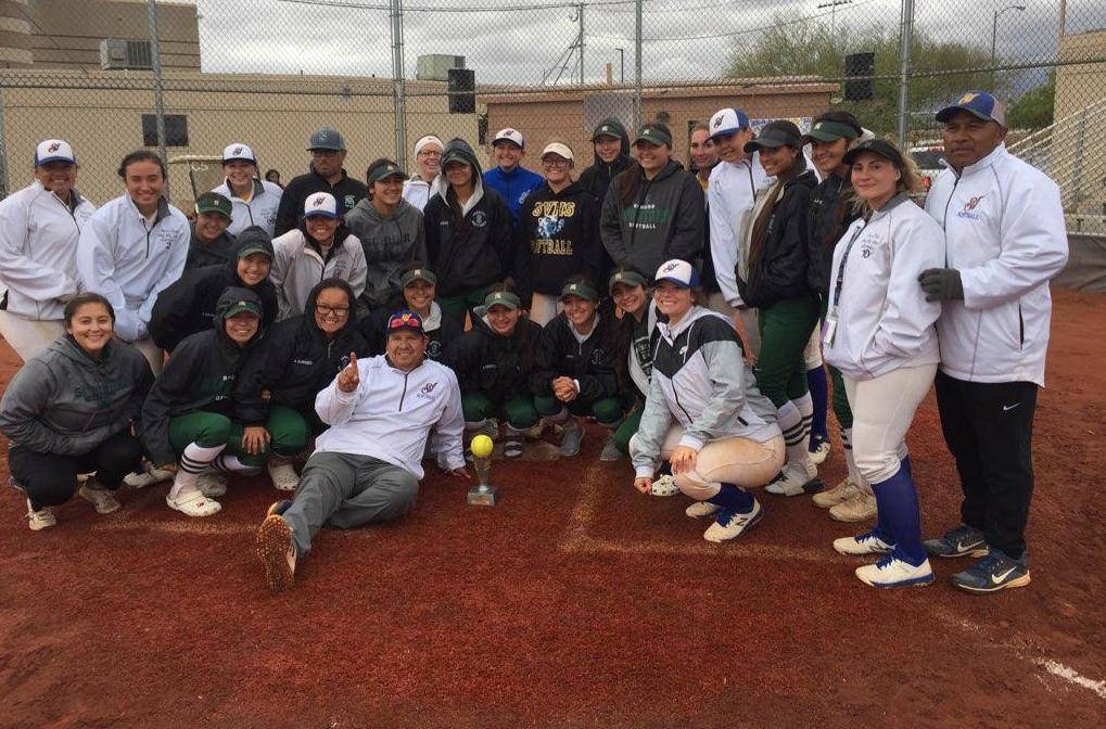 Members of the Sierra Vista and Schurr (California) softball teams pose for a group photo af ...