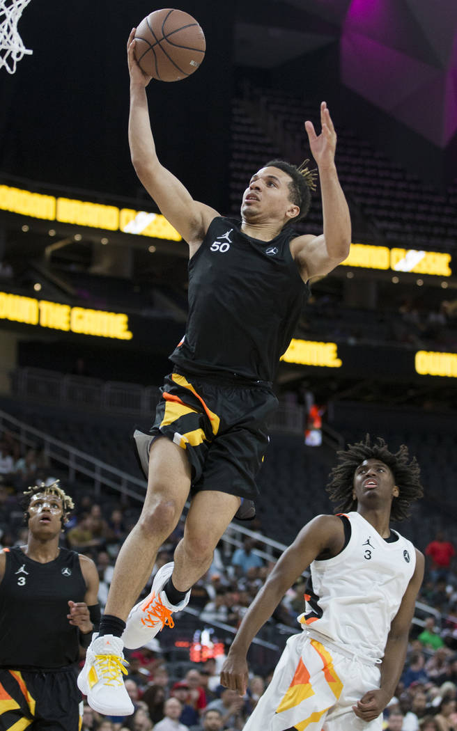 Cole Anthony (50) slices to the rim past Tyrese Maxey (3) in the first half during the Jorda ...