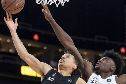 Cole Anthony (50) drives past Isaiah Stewart (33) in the first half during the Jordan Brand ...
