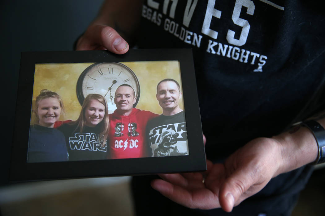 Chris Jachimiec shows a picture with his siblings including Adam Jachimiec, third from left, a ...