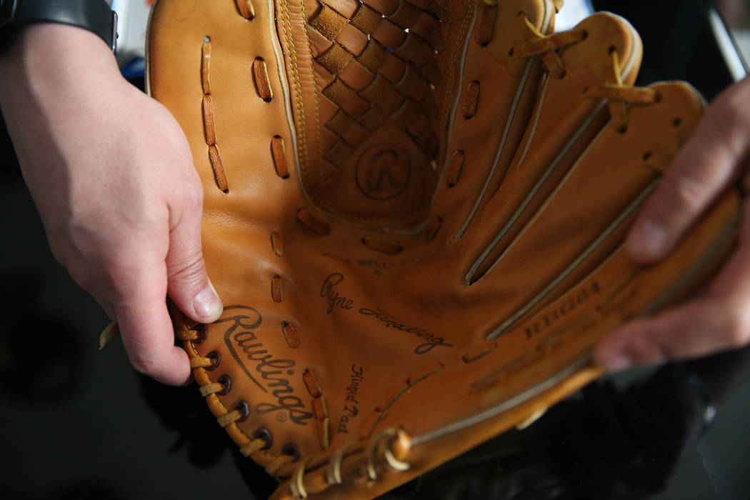 Chris Jachimiec shows a baseball glove that belonged to his brother Adam, Friday, March 8, 2019 ...