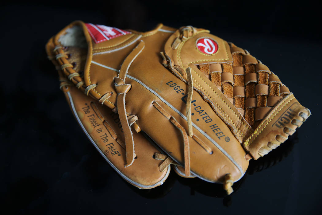 At the home of Chris Jachimiec, a baseball glove that belonged to his brother Adam, Friday, Mar ...