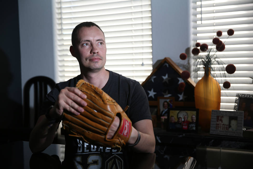 Chris Jachimiec at his home in Las Vegas, wears a baseball glove that belonged to his brother A ...