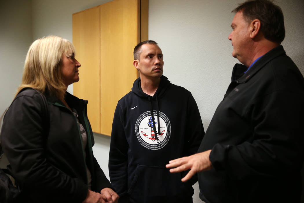 Chuck Reineck, right, with his wife Jeanette, left, speaks to Chris Jachimiec following their s ...