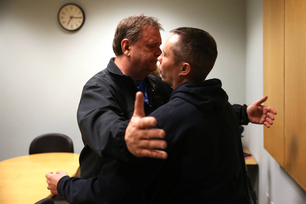 Chuck Reineck, left, hugs Chris Jachimiec after their support group meeting at the Rainbow Libr ...
