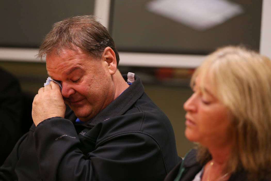 Chuck Reineck, left, wipes tears while speaking about the loss of his son during a support grou ...