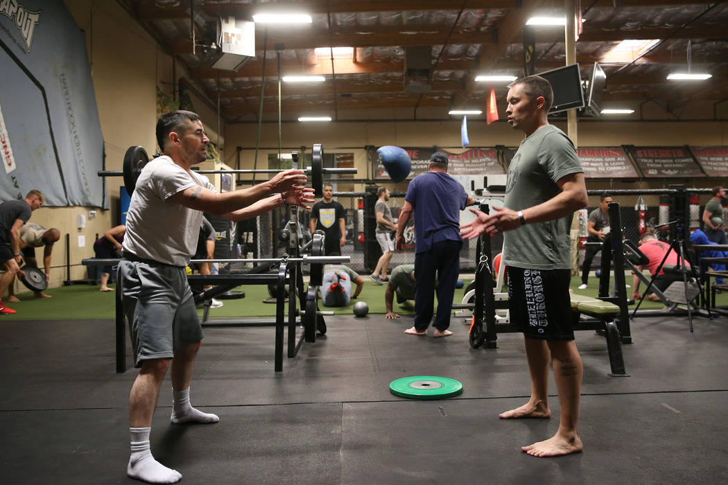 Military veterans Chris Jachimiec, right, with Erik Zambrano, work out during a Merging Vets An ...