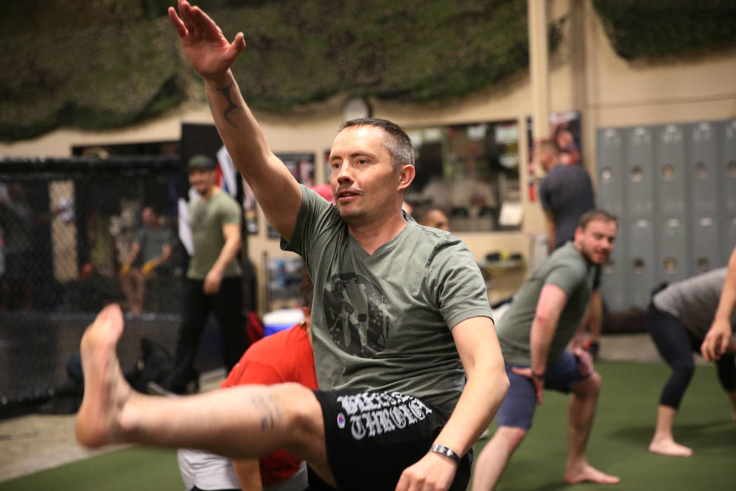 Military veteran Chris Jachimiec works out during a Merging Vets And Players class at Xtreme Co ...