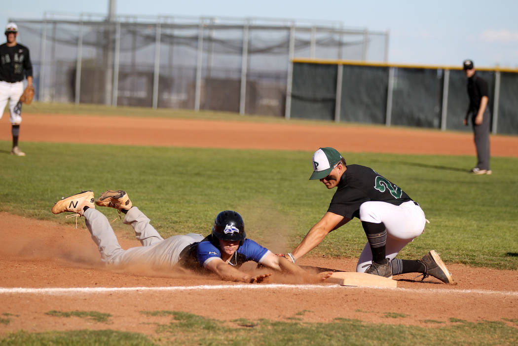 Palo Verde third baseman Paul Myro (23) tags out Basic Dalton Miller baserunner (13) in the ...