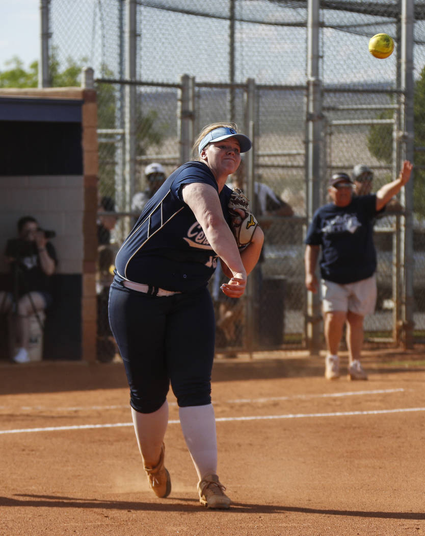 Centennial pitcher Amanda Sink (18) throws the ball to first base in the fourth inning of th ...