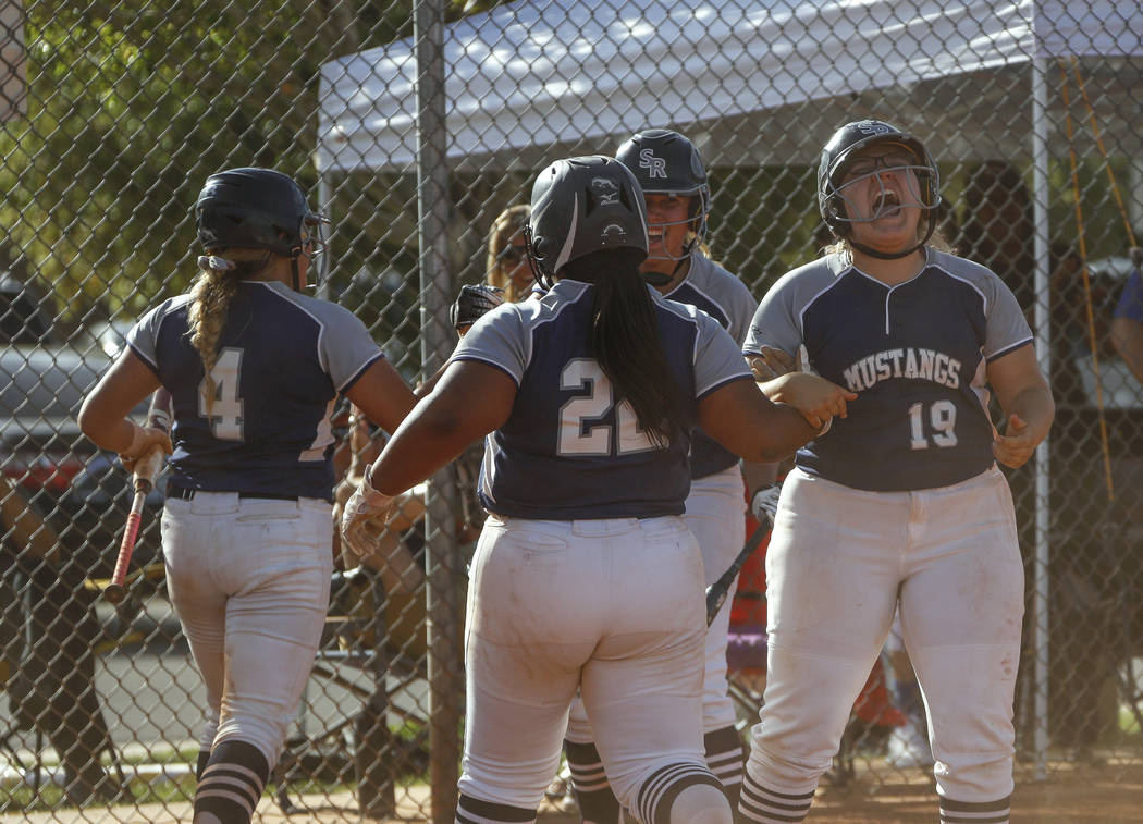 Shadow Ridge players cheers after catcher Shea Clements (4) scores the first run of the game ...