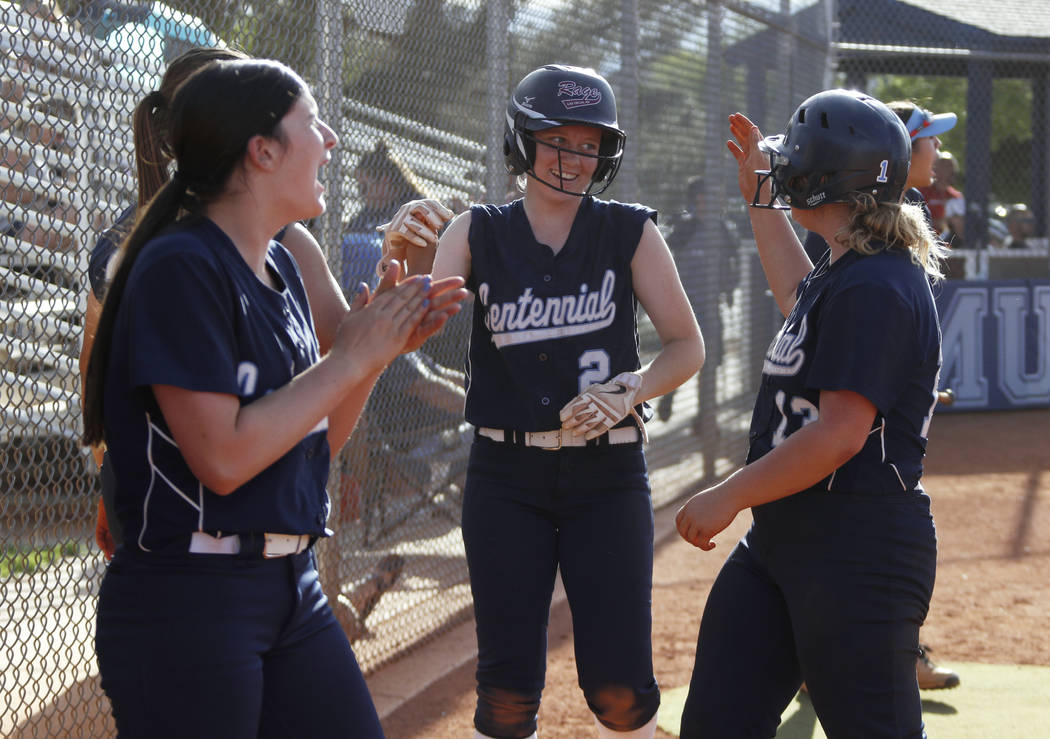 Centennial infielder Ryan Rogers (2) is cheered on by her teammates after scoring a run in t ...