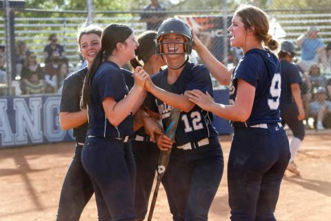 Centennial's Abby Hanley (12) is congratulated by her teammates after scoring a run in ...