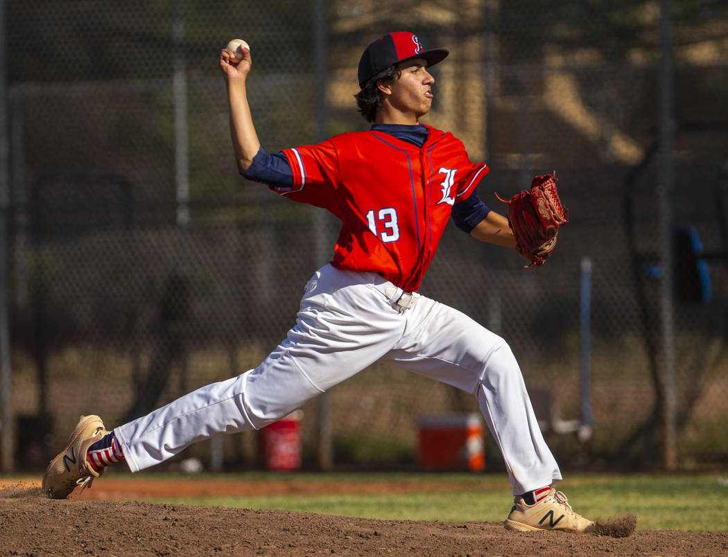 Liberty pitcher Devin Contreras (13) sends another throw towards the plate versus Spring Val ...