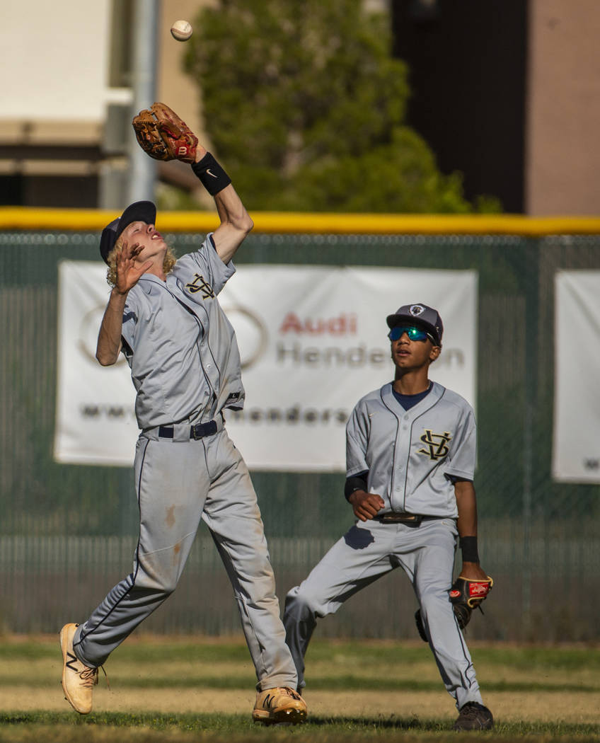 Spring Valley's Chasyn Love (23) looks in a pop fly versus Liberty during the first ro ...